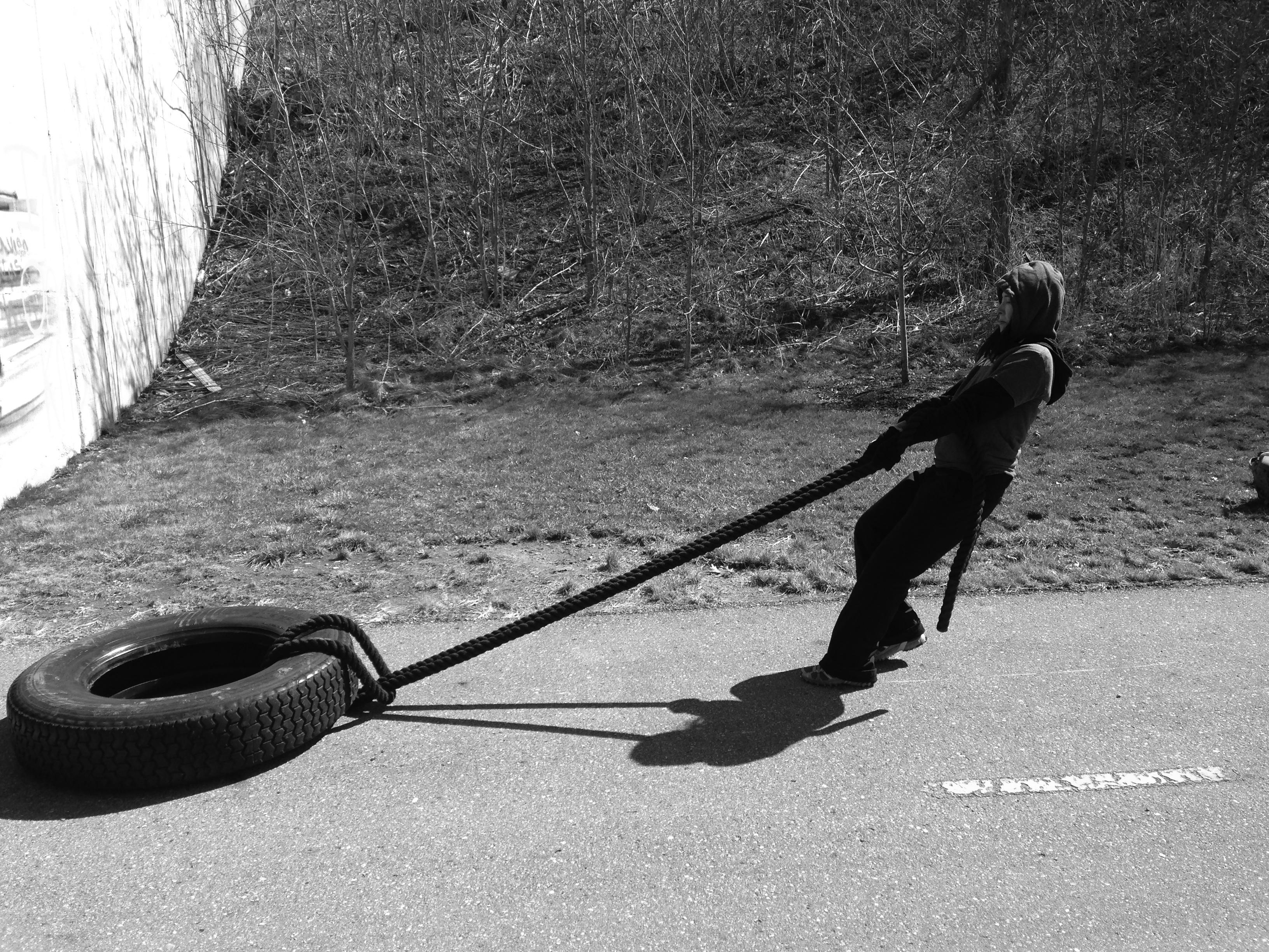 fran-pulling-tire-dc-bw